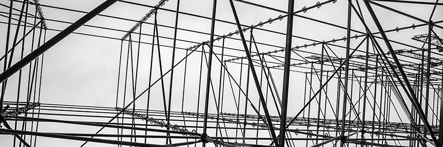 Black-and-white photo of construction scaffolding.